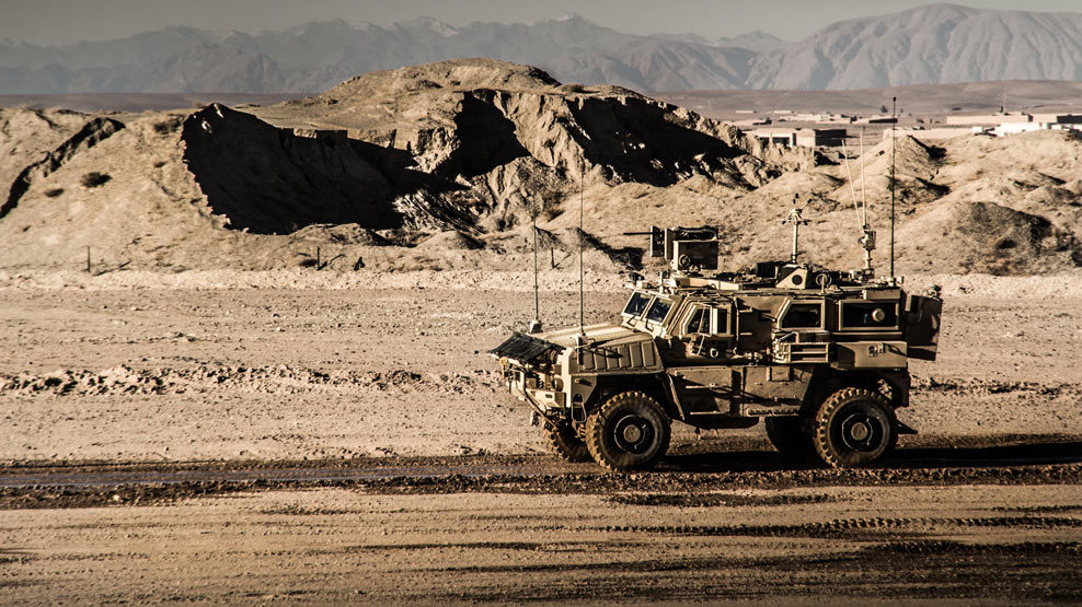 Military -vehicle -in -desert -afg -988x 555